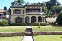 This is a 5 bedroom house for sale in the posh suburb of Muyenga in Kampala with a green compound at 500,000 USD