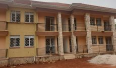 8 units apartment block for sale in Kyaliwajjala making 4.8m monthly at 700m