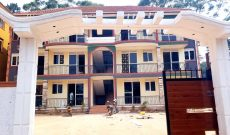 12 units apartment block for sale in Kyaliwajjala 8.4m monthly at 1.2 billion shillings