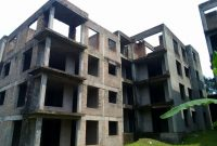shell apartment block for sale in Kololo on 1 acre at 3.2m USD