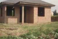 50x100ft plot of land for sale with boys' quarters at 35m